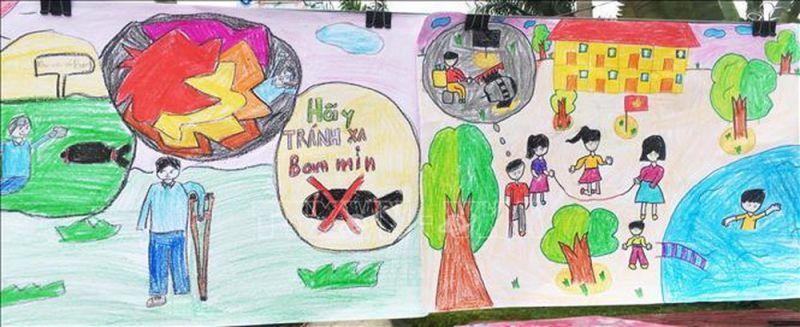 Trẻ em vẽ tranh cổ động phòng chống bom mìn