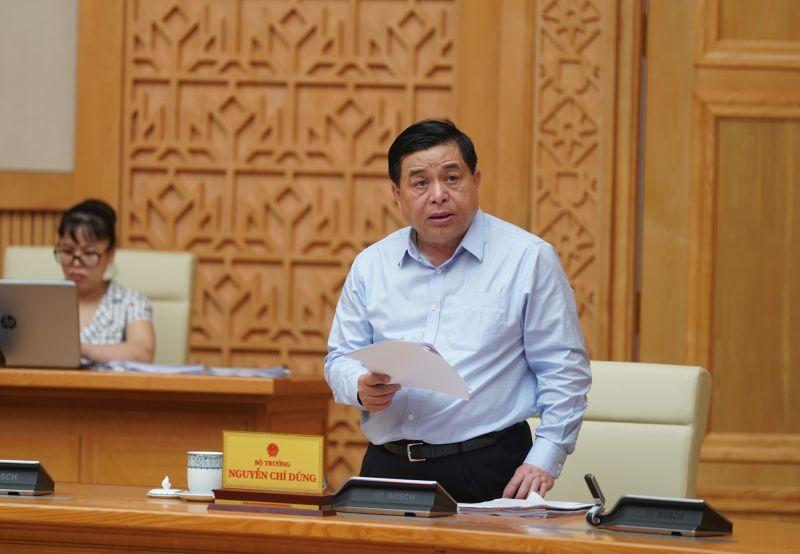 Bộ trưởng Bộ Kế hoạch và Đầu tư Nguyễn Chí Dũng phát biểu tại phiên họp. - Ảnh: VGP/Quang Hiếu