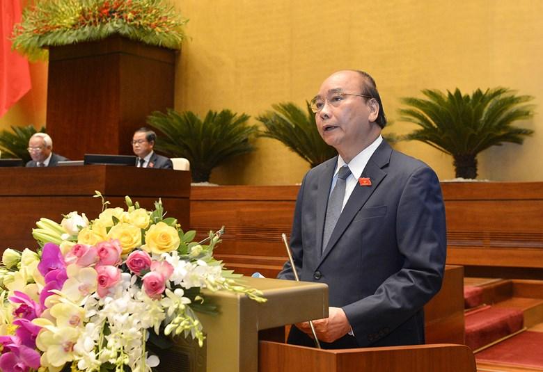 Thủ tướng Chính phủ Nguyễn Xuân Phúc báo cáo về hoạt động phòng, chống dịch Covid-19 và những nhiệm vụ, giải pháp trọng tâm phục hồi, phát triển kinh tế - xã hội.