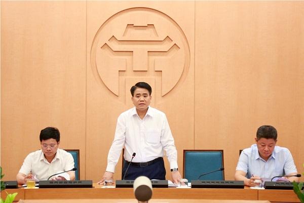 Chủ tich TP. Hà Nội Nguyễn Đức Chung, Trưởng Ban chỉ đạo xây dựng Chính phủ điện tử Thành phố phát biểu tại phiên họp. Ảnh: Thùy Linh