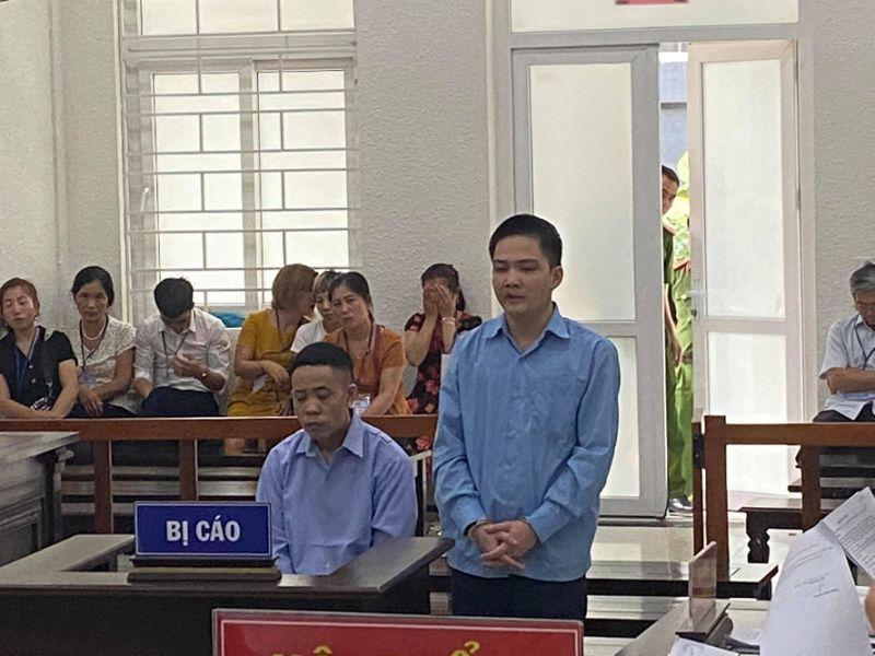 Hai bị cáo Nguyễn Đức Cảnh và Nguyễn Mạnh Thực tại tòa.