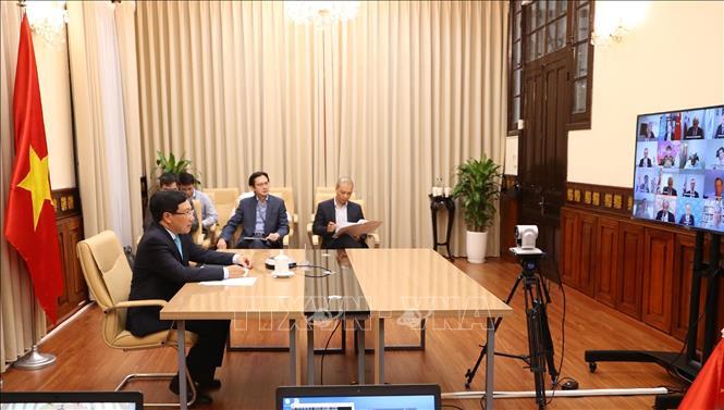 Phó Thủ tướng, Bộ trưởng Bộ Ngoại giao Phạm Bình Minh dự phiên Thảo luận mở trực tuyến của Hội đồng Bảo an Liên hợp quốc. Ảnh: Lâm Khánh/TTXVN.
