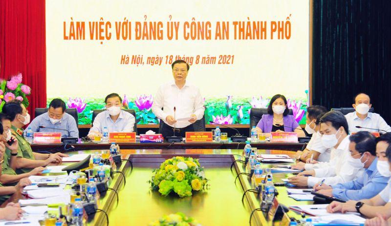 Bí thư Thành ủy Hà Nội Đinh Tiến Dũng chủ trì buổi làm việc giữa Thường trực Thành ủy Hà Nội với Đảng ủy Công an thành phố Hà Nội.