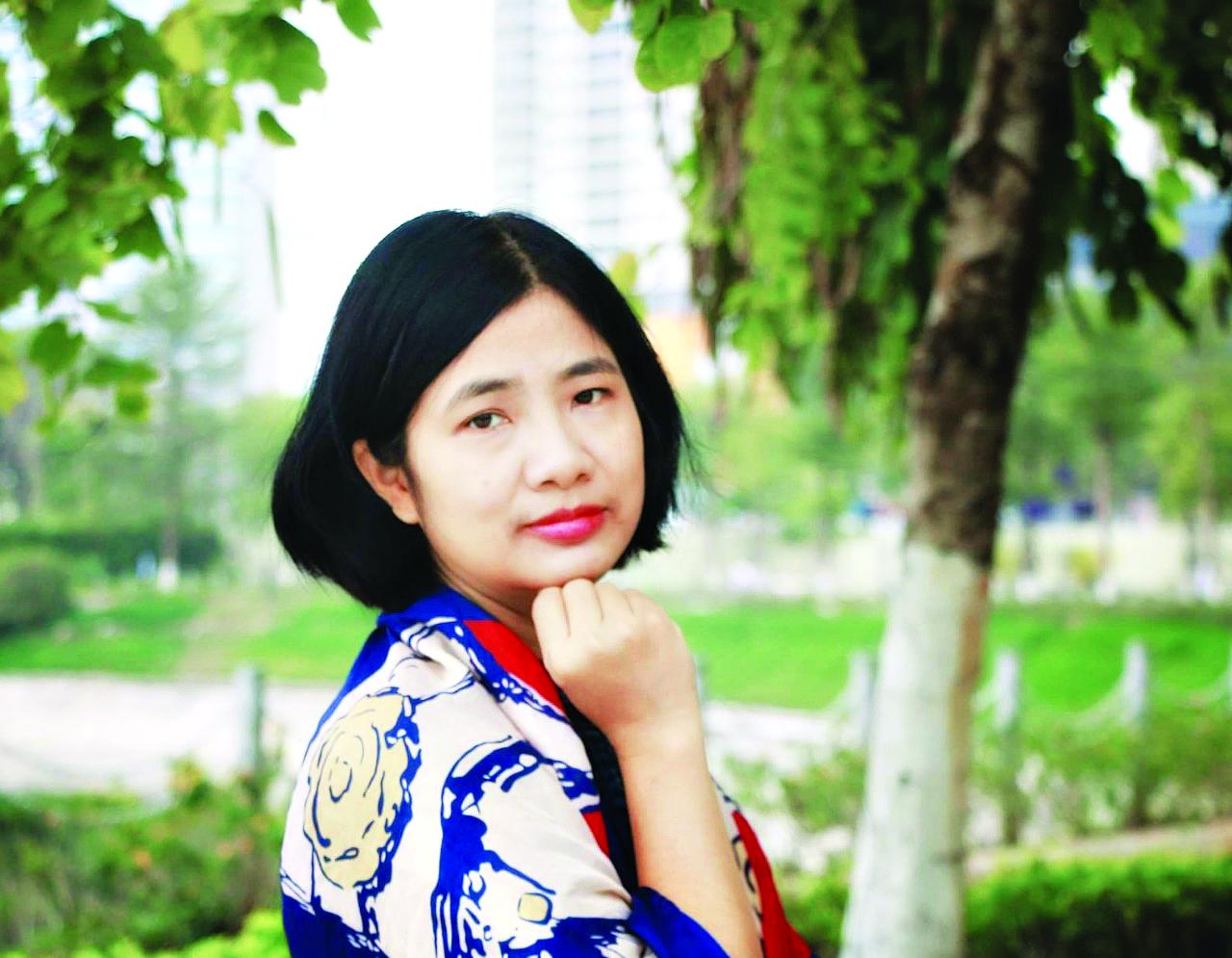 Nhà báo Trần Hoàng Lan - Biên tập viên Ban Thư ký tòa soạn, phụ trách mảng giáo dục