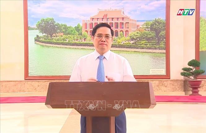 Thủ tướng Chính phủ Phạm Minh Chính phát biểu tại chương trình trực tuyến (ảnh chụp qua màn hình). Ảnh: Thu Hương/TTXVN